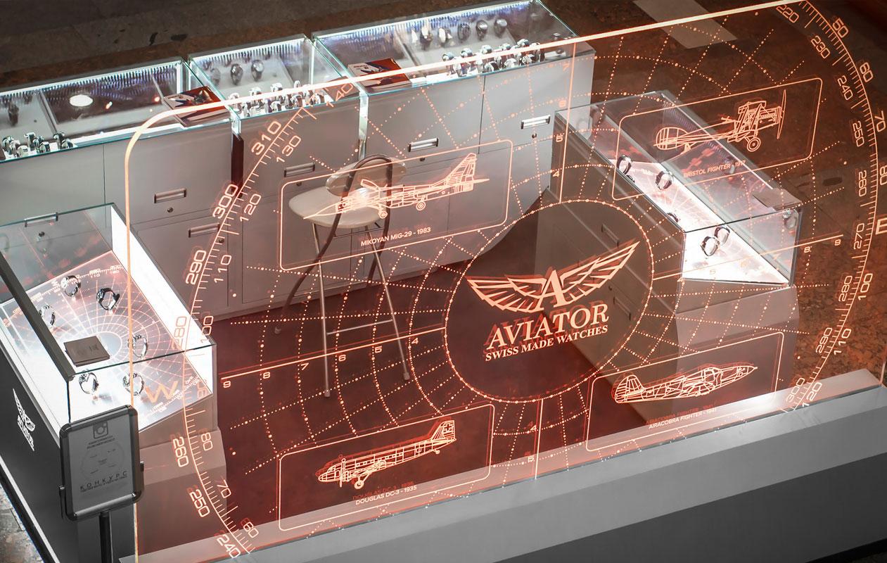 Transparente Leuchttafel aus Lightgraphic mit orange leuchtenden aeronautischen Motiven. Foto: axis